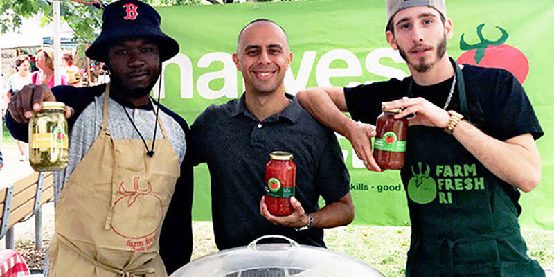 Photo of Mayor Jorge O. Elorza with Harvest Kitchen staff at their market stand